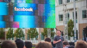 Facebook squeaks by revenue estimates, but shares plunge